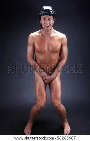 Image of naked man in hockey helmet over black background - stock photo