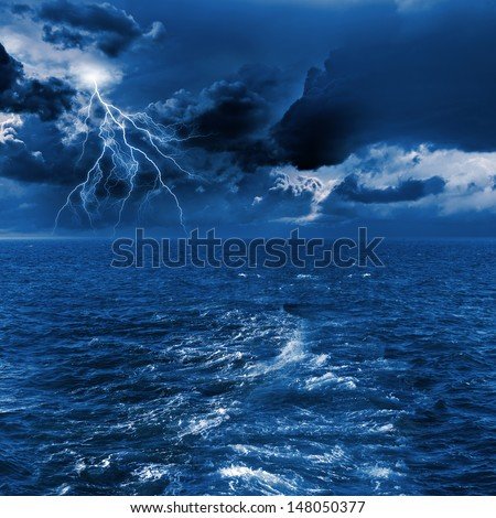 Image of night stormy sea with big waves and lightning - stock photo