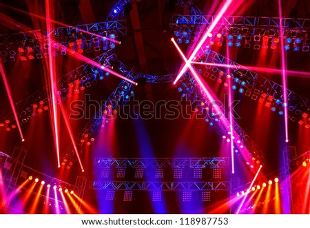 Image of nightclub lights, red spotlight beam in the dance club, Christmas celebration, clubbing life, colorful festive rays on the stage on concert, New Year party, laser performance, holiday concept - stock photo