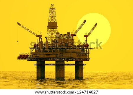 Image of oil platform during sunset. - stock photo