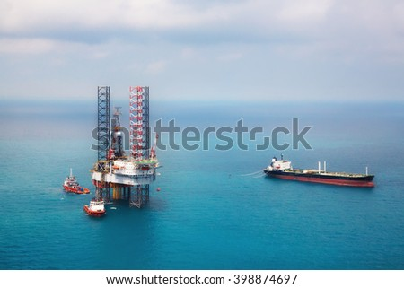 Image of oil platform while cloudless day  in the gulf - stock photo