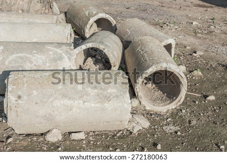 image of Old and cracked concrete pipe for watering. - stock photo