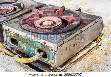 image of Old gas burner and stove close up. - stock photo