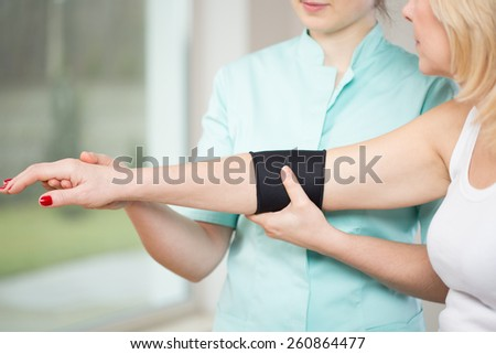 Image of patient after injury using elbow stabilizer - stock photo