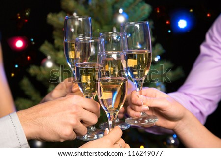 Image of people hands with crystal glasses full of champagne - stock photo
