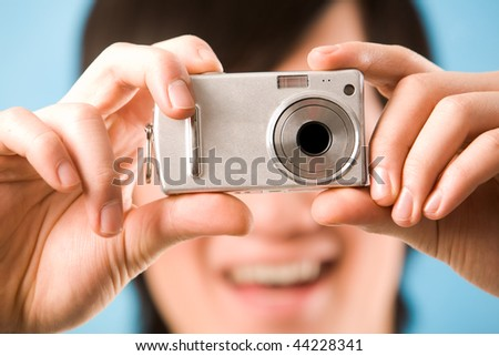 Image of photo camera in male hands ready to make a shot - stock photo