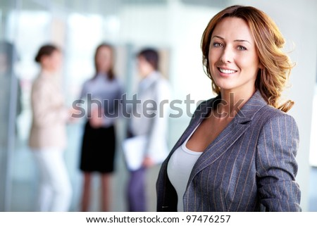 Image of pretty business leader looking at camera - stock photo