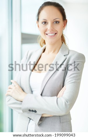 Image of pretty businesswoman looking at camera with smile - stock photo