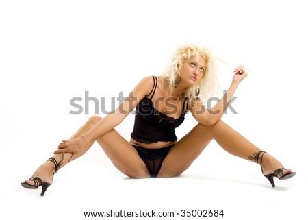 Image of pretty female in black playing with her hair - stock photo