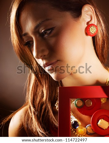 Image of pretty woman wearing fashionable colorful accessories, closeup portrait of attractive girl in stylish great bijouterie, sexy young lady isolated on dark background, luxury beauty salon - stock photo