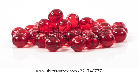 Image of red pills isolated close up - stock photo