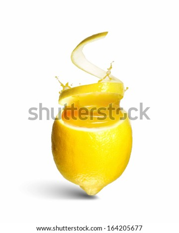 Image of refreshing lemon cocktail with juicy splashes - stock photo