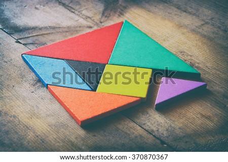 image of retro tangram puzzle. retro style image - stock photo