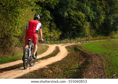 Image of Rider in action at Freestyle Mountain Bike Session in the Forest - stock photo