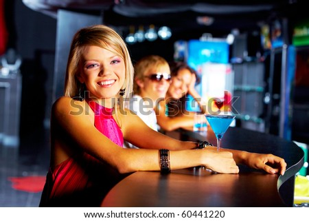 Image of row of smiling teens with pretty girl in front in the nightclub - stock photo