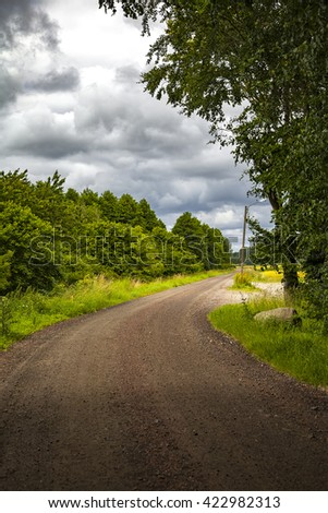 Image of rural dirt road in south Sweden.  - stock photo