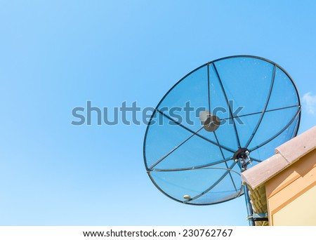 image of satellite on roof with blue sky . - stock photo