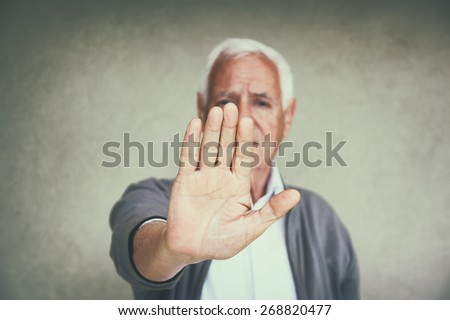 image of senior man showing his hand as stop sign. senior care concept  - stock photo