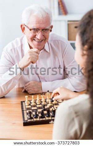 Image of senior spending leisure time with carer - stock photo