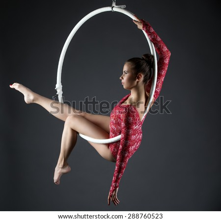 Image of sexy acrobatic girl posing with hoop - stock photo