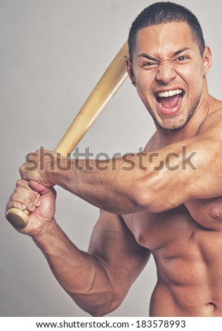 Image of sexy baseball player with bat - stock photo