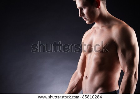 Image of shirtless man over dark background - stock photo