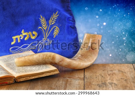 image of shofar (horn) and prayer case with word talit (prayer) writen on it. room for text. rosh hashanah (jewish holiday) concept . traditional holiday symbol.  - stock photo