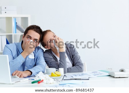 Image of sick business partners with rhinitis sitting in office - stock photo