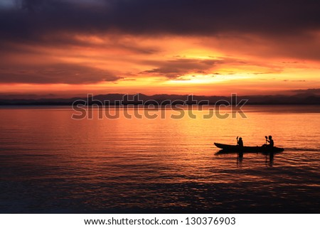 Image of silhouette, Rower at sunset - stock photo