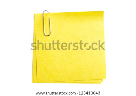 Image of silver paper clip with yellow paper isolated on white background - stock photo
