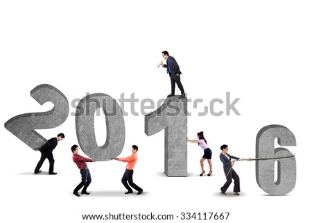 Image of six young businesspeople work together to arrange numbers 2016. Isolated on white background - stock photo