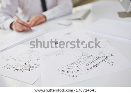 Image of sketches at workplace - stock photo
