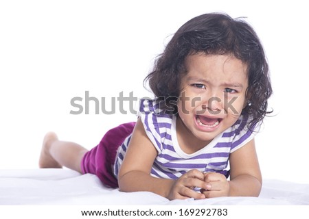 Image of Small child is crying hard on white background - stock photo
