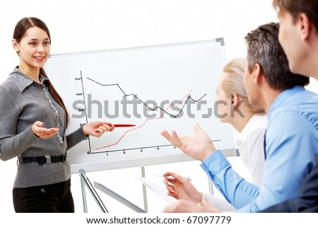 Image of smart business woman looking at their partners while she explaining something on whiteboard - stock photo
