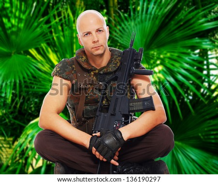 image of soldier who is sitting in a turkish position - stock photo