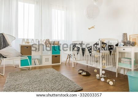 Image of spacious infant bedroom with white furniture - stock photo