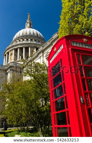 Image of St Paul's Cathedral, London, England with a red phone box in the foreground - stock photo