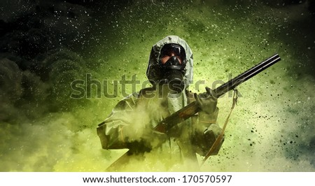 Image of stalker with gun. Ecology catastrophe - stock photo