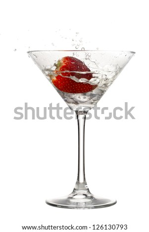 Image of strawberry on cocktail glass isolated on white background - stock photo