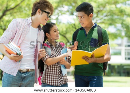 Image of students explaining something to their friend - stock photo