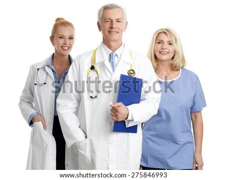 Image of successful healthcare worker. Portrait of medical assistant standing next to mature female doctor and senior doctor. Isolated on white background.  - stock photo