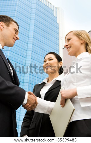 Image of successful partners handshaking after signing an agreement - stock photo