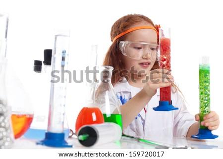 Image of surprised little experimenter in studio - stock photo