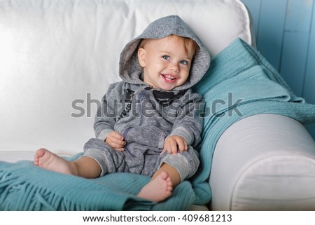 Image of  sweet baby boy, closeup portrait of child, cute toddler with blue eyes - stock photo