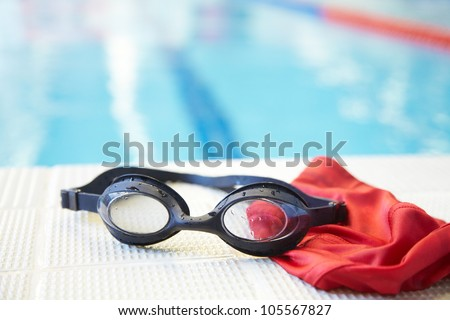 Image of swimming pool, goggles and swimming hat. Nobody - stock photo