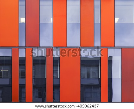 Image of symmetrical modern architecture with glass fronts. - stock photo