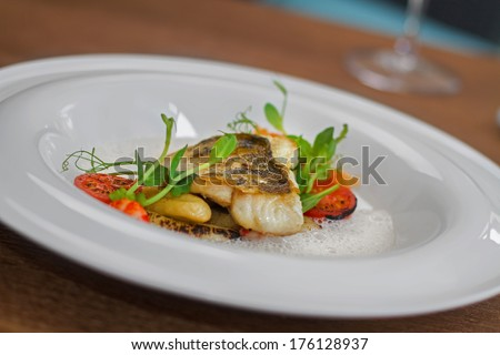 Image of tasty fish served in restaurant - stock photo