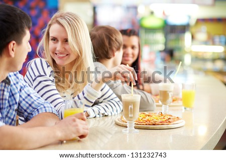 Image of teenage couple interacting in cafe - stock photo