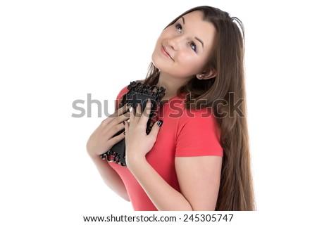 Image of teenage girl holding photo frame on white background - stock photo