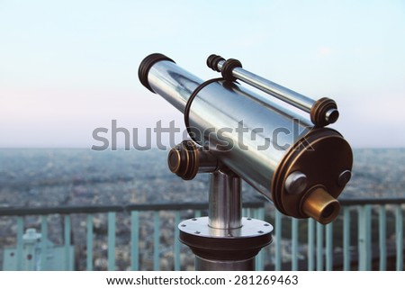 Image of telescope overlooking for city - stock photo